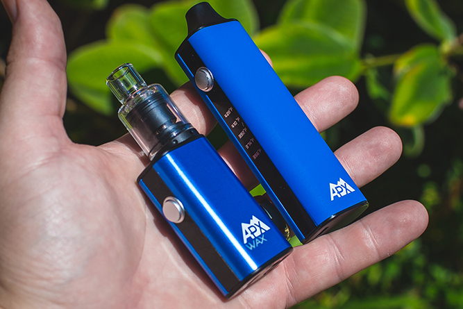 Holding onto the Pulsar APX dry herb and Wax vaporizers.
