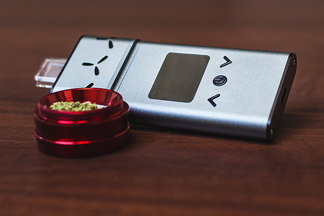 AirVape Xs digital vaporizer and some ground cannabis.